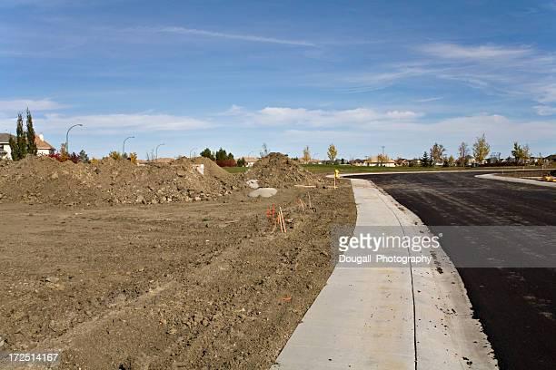 street and sidewalk in new saskatoon neighborhood - saskatoon stock pictures, royalty-free photos & images