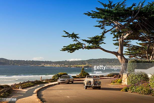 street and walkway on carmel beach in carmel-by-the-sea - monterrey stock pictures, royalty-free photos & images