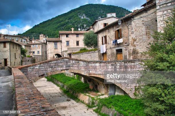 street architecture and canal in medieval gubbio - gubbio stock pictures, royalty-free photos & images