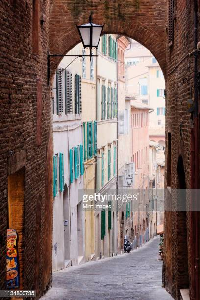 street archway - siena italy stock pictures, royalty-free photos & images
