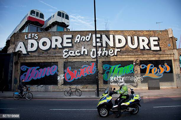 Street art by Ben Eine spells the phrase 'Home Sweet Home Less' in the East End of London is an ever changing visual enigma as the artworks...