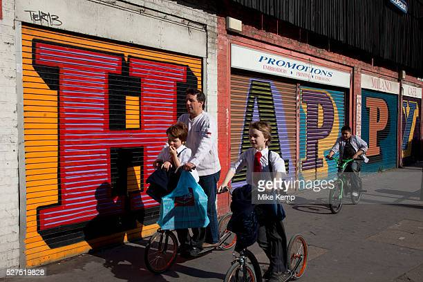 Street art by Ben Eine spells the word 'Happy' in the East End of London is an ever changing visual enigma as the artworks constantly change as...