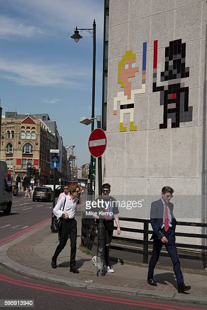 Street art by Invader of Luke Skywalker and Darth Vader in Shoreditch East London United Kingdom Street art in the East End of London is an ever...