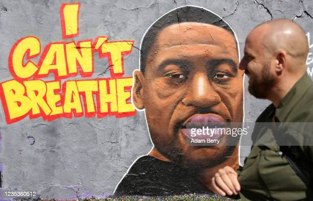 Street art commemorating George Floyd killed in police custody in Minneapolis after footage emerged of him pleading for air as a police officer...