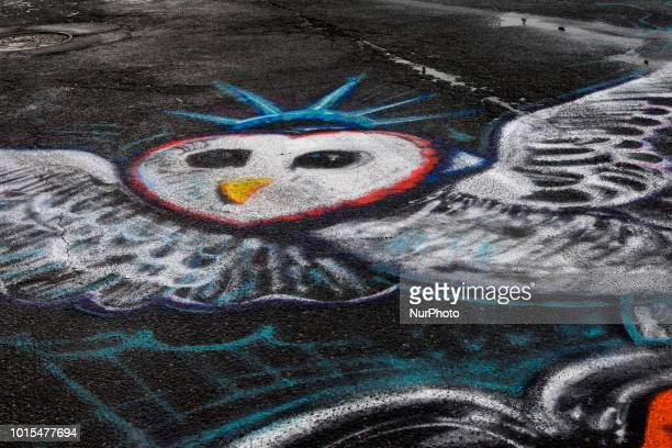 Street art found near the Broad St and Erie avenue intersection as thousands of pedestrians cyclist skaters joggers participate in the third annual...