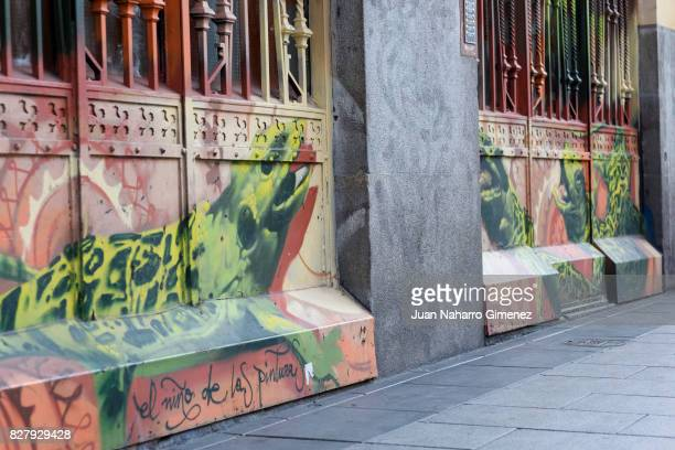 Street art graffiti is seen in the neighborhood of Malasaña of Madrid on July 19 2017 in Madrid Spain