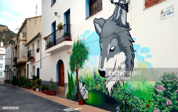 A street art mural is pictured on the facade of a house in Fanzara near Castellon de la Plana on December 15 2016 Fanzara a Spanish hamlet in the...