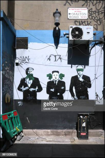 Street art mural showing illustrations of US President Donald Trump North Korean leader Kim Jongun and President of Russia Vladimir Putin on a wall...