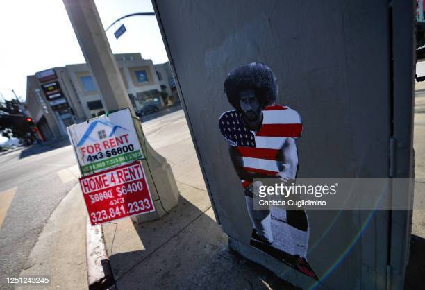 Street art of Colin Kaepernick taking a knee is seen on the corner of Melrose Avenue and Fairfax Avenue on June 21, 2020 in Los Angeles, California....