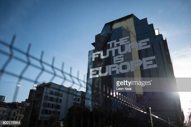 """Street art reading """"The Future Is Europe"""" is seen on the side of building near to the European Council headquarters on June 23, 2017 in Brussels,..."""