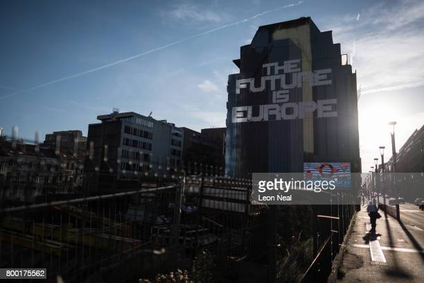 Street art reading 'The Future Is Europe' is seen on the side of building near to the European Council headquarters on June 23 2017 in Brussels...