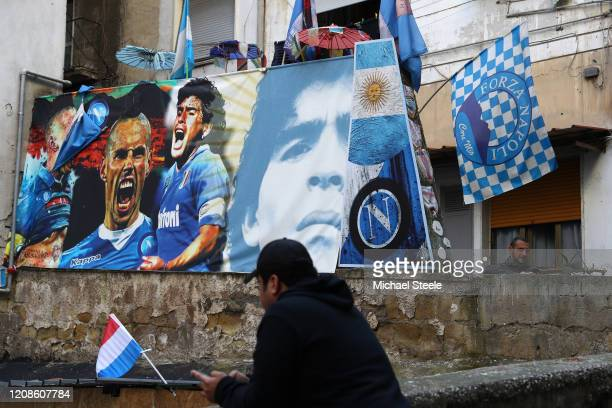 Street art showing ex Napoli player s Diego Maradona and Marek Hamsik in the city of Naples ahead of the UEFA Champions League round of 16 first leg...