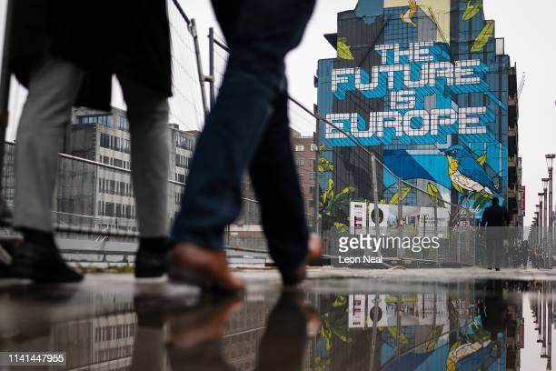 Street art titled The Future Is Europe by Belgian artist NovaDead is seen near to the headquarters of the European Council of Ministers on April 09...