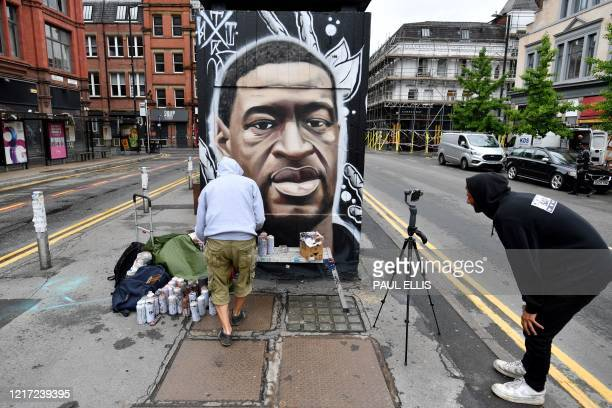 Street artist Akse spray paints a mural of George Floyd, an unarmed black man who died after a police officer knelt on his neck during an arrest in...