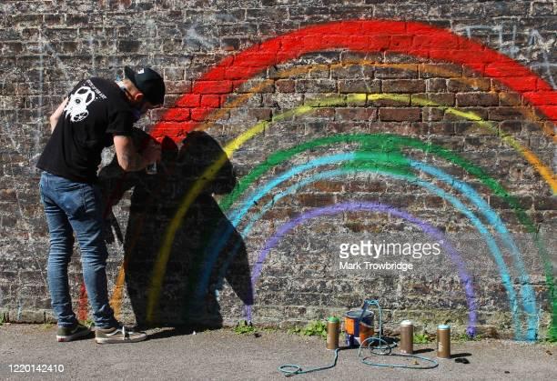 Street artist Chris Shea works on his 100th 'Rainbow Boy' artwork at The Swan public house on April 21, 2020 in West Wickham, United Kingdom. Shea...