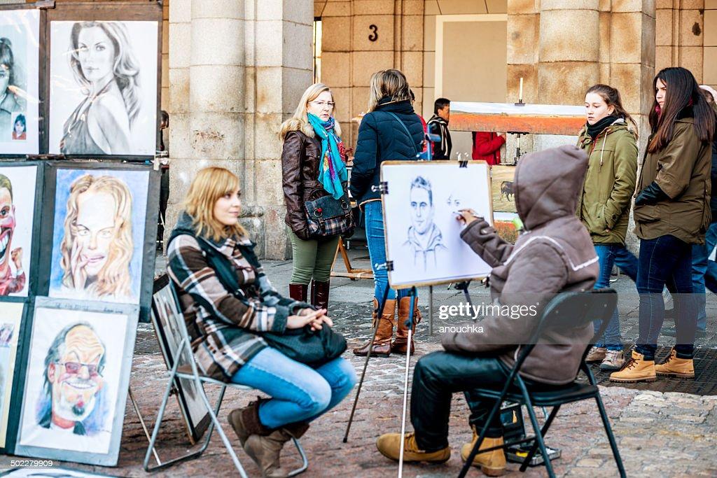 Street Artist drawing portrait, Plaza Mayor, Madrid : Stock Photo
