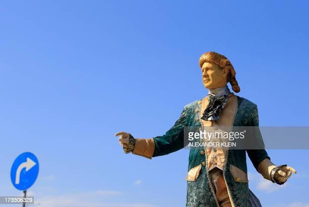 A street artist dressed up as Austrian cmposer Wolfgang Amadeus Mozart poses on a sunny day in Vienna on July 11 2013 AFP PHOTO / ALEXANDER KLEIN