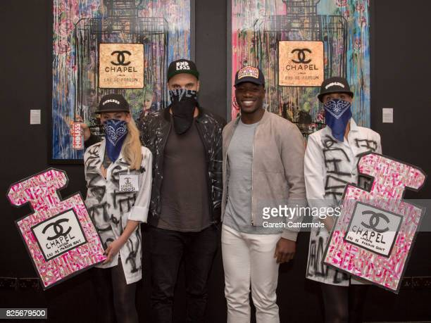Street artist Endless and Tobi Alabi attend the 'Endless Presents Beaut' VIP launch at The Exhibitionist Hotel on August 2 2017 in London England