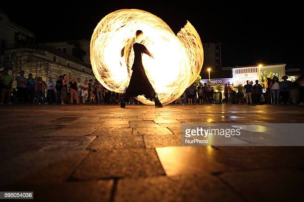 Street artist in a fire performance in Monastiraki square in Athens on Jun 20 2015