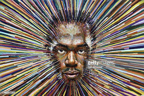 Street artist James Cochran Aka Jimmy C puts the finishing touches to a piece of work depicting the face of Jamaican sprinter Usain Bolt on July 20...