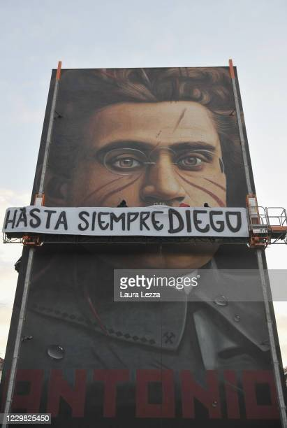Street artist Jorit's mural of philosopher and politician Antonio Gramsci pays tribute to football player Diego Armando Maradona with a banner that...