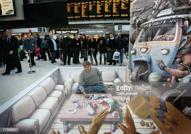 Street artist Kurt Wenner adds the finishing touches to a 3D work of art in Waterloo Station on October 17 2007 in London England The image was...