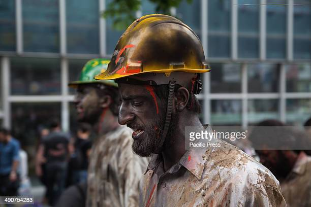 Street artist made up as dead miner walk in protest of the death of hundreds of miners in a coal mine in Soma . Official death toll rose 274 after...
