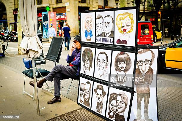 Street Artist making caricatures of tourists for money, Barcelon