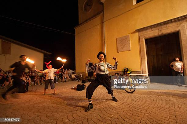 CONTENT] Street artist perform during Canalarte street art Festival in Canale del Serino Italy