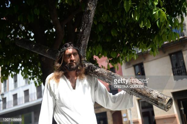 Street artist performs as a Jesus Christ living statue on March 14 in Seville. - Seville decided today to cancel its famous Holy Week processions,...
