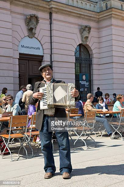 Street artist playing accordion in berlin