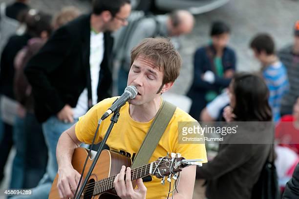 Street artist playing guitar in paris