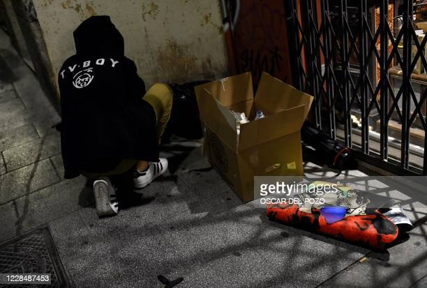 """Street artist TVBoy prepares to paste a new artwork entitled """"Tokyo Loves Nairobi"""" depicting a rainbow-coloured heart along with two characters from..."""