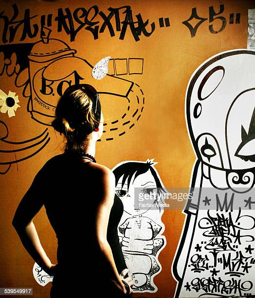 Street artist Vexta with some of her stencil art at the Meat Market North Melbourne 24th February 2005 AGE METRO Picture by RODGER CUMMINS