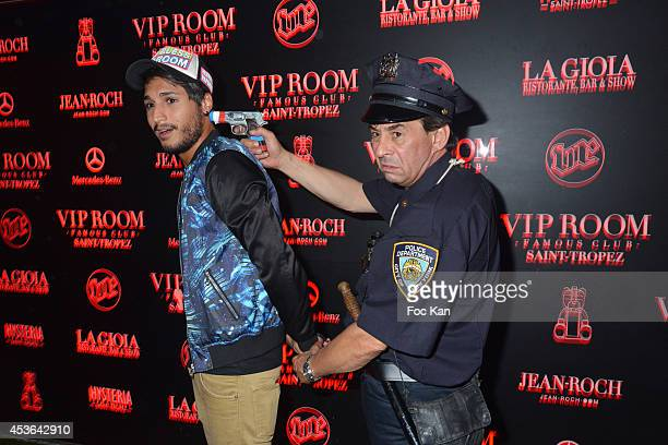 Street artist/comedian Patrick Chagnaud well known as 'Gendarme de Saint Tropez' and VIP Room PR Mehdi attend the DJ Ruckus Party at the VIP Room...