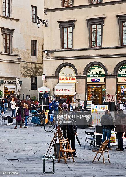 Street artists and tourists: Piazza del Duomo, Florence, Italy