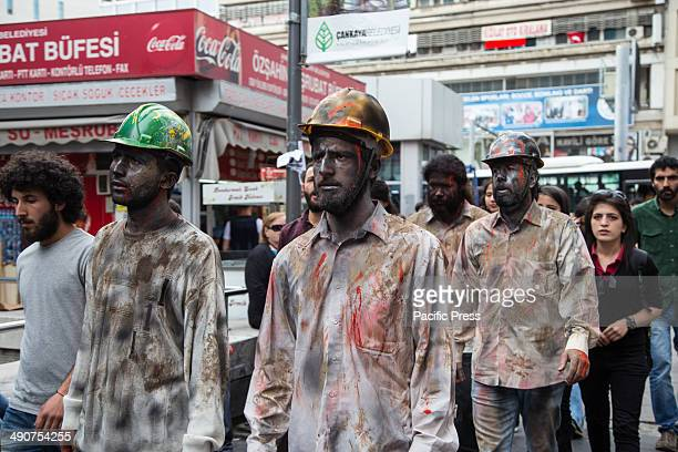 Street artists made up as dead miners walk in protest of the death of hundreds of miners in a coal mine in Soma . Official death toll rose 274 after...