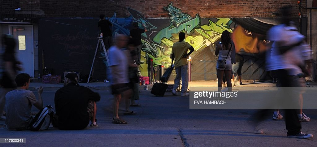 Street artists paint a wall in the Quart : News Photo