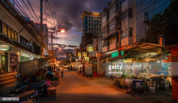 street at dusk in chiang mai, thailand - chiang mai province stock photos and pictures
