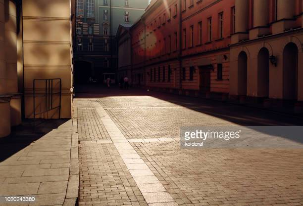 street at midday with harsh shadow - diminishing perspective stock pictures, royalty-free photos & images