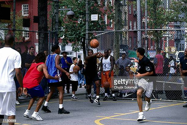 A street ball player makes a pass during a pickup game at a playground on West 4th Street on September 13 1997 in New York NOTE TO USER User...