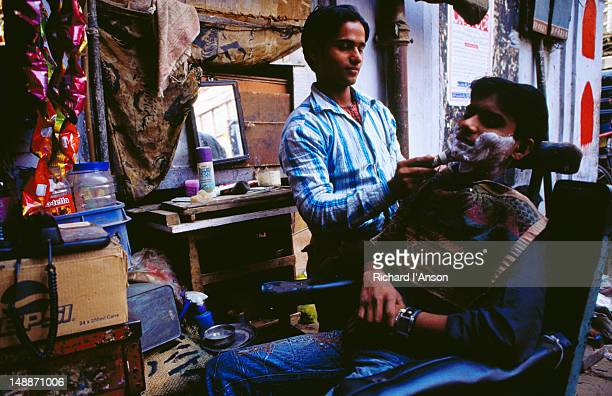 Street barber in Khari Baoli or Spice Market, Old Delhi.