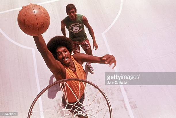 Street Basketball Aerial view of Syracuse Dennis DuVal during playground action at New Cassell Park Westbury NY 8/19/1973