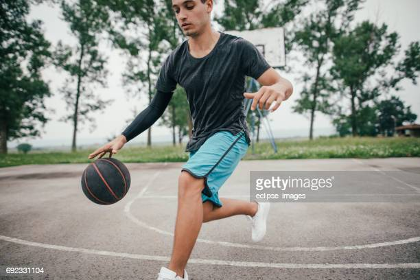 Street basketball player on the court