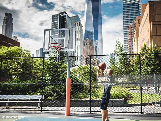 street basketball player shooting at goal