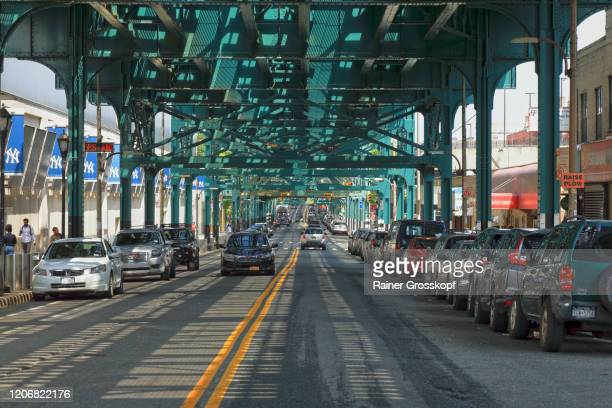 street below an elevated subway in the bronx - rainer grosskopf stock pictures, royalty-free photos & images