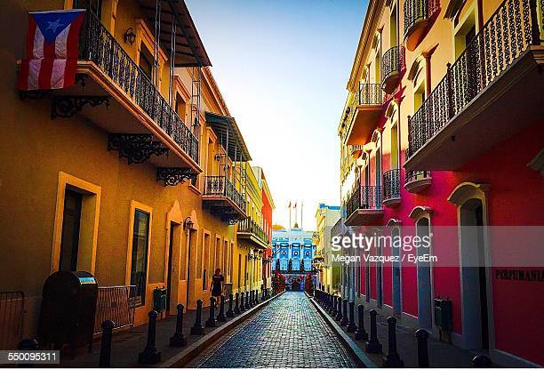 street between multi colored buildings - puerto rico stock pictures, royalty-free photos & images
