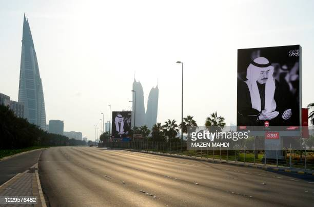 Street billboards mourning the death of Bahraini Prime Minister, Prince Khalifa bin Salman al-Khalifa, line a highway in the capital Manama, on...