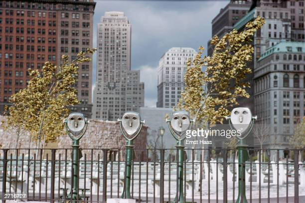 Street binoculars in Battery Park New York give the appearance of blankeyed faces Original Publication Colour photography book