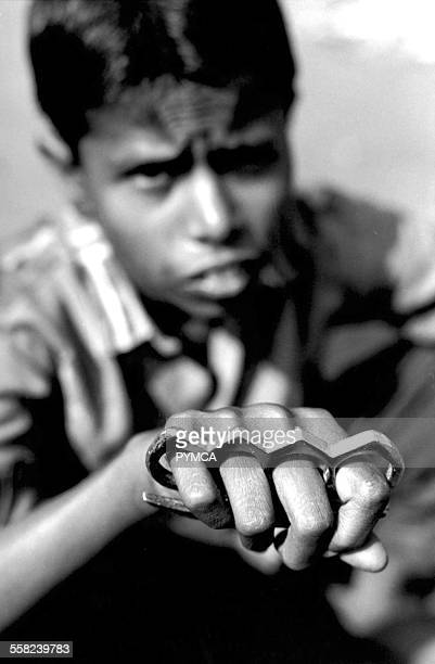 Street boy with knuckleduster Calcutta India 1990s